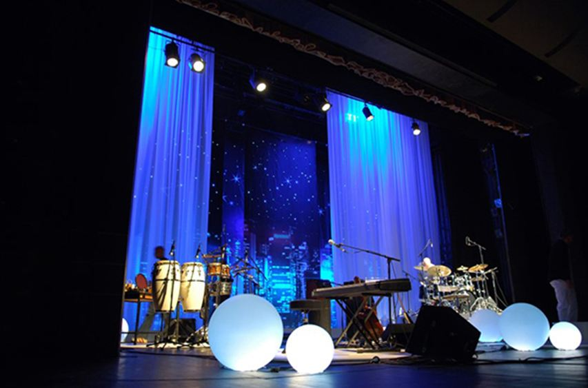 stage hire humphries av blue lighting draping and instruments on stage