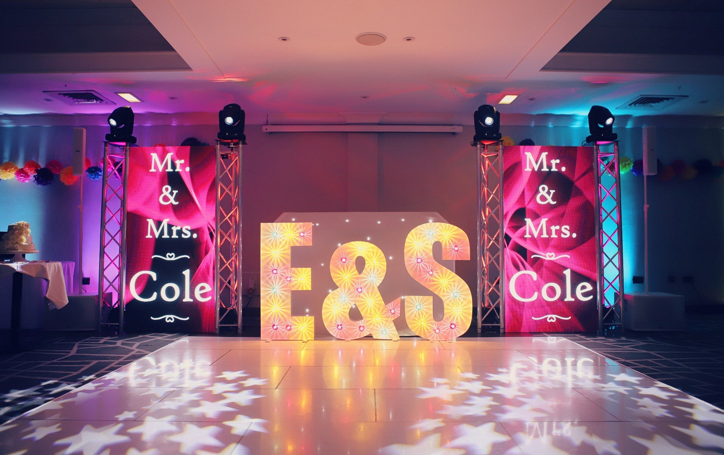 Wedding production by Humphries AV showing pink and yellow theme